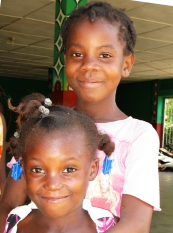 Photo of two smiling Haitian girls
